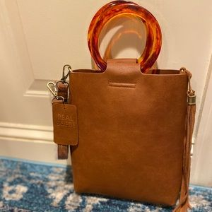 Leather tote with lucite tortoise shell handles